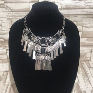 Silver tone faux coin chunky necklace.